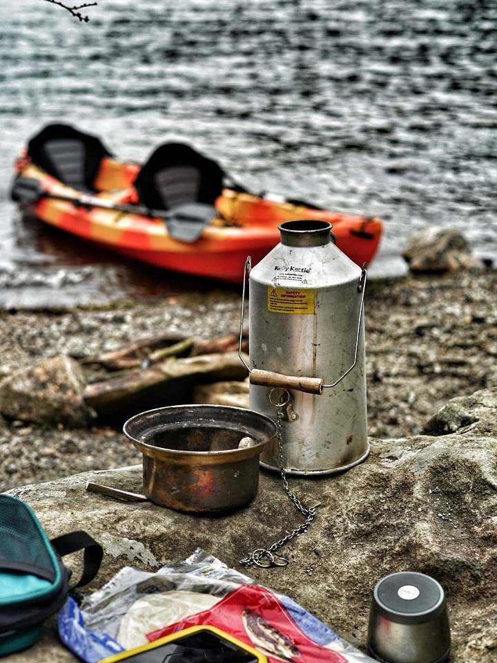 Dad and daughter kayaking at Llyn Gerionydd (Wales, U.K.) with our Kelly Kettle. Lots of pine cones and pine debris to burn. Can't beat a warm drink after a long paddle.