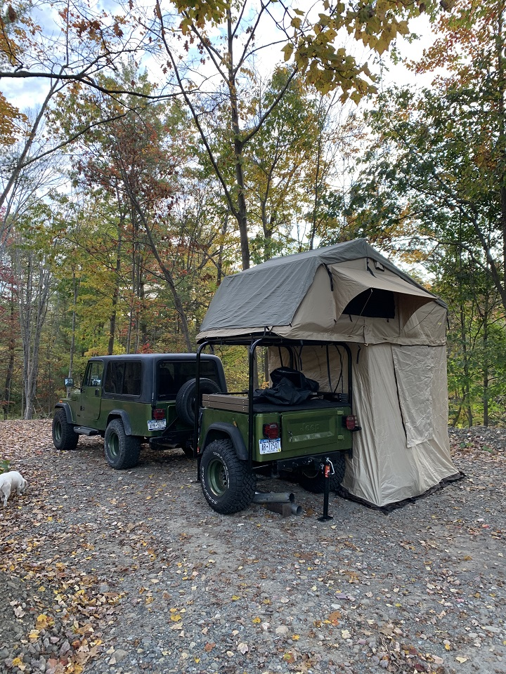 This is our custom'84 Jeep Scrambler with our custom homemade Jeep trailer with rooftop tent we built to do some family camping. We would love a Kelly Kettle to go with it to add to the memories!