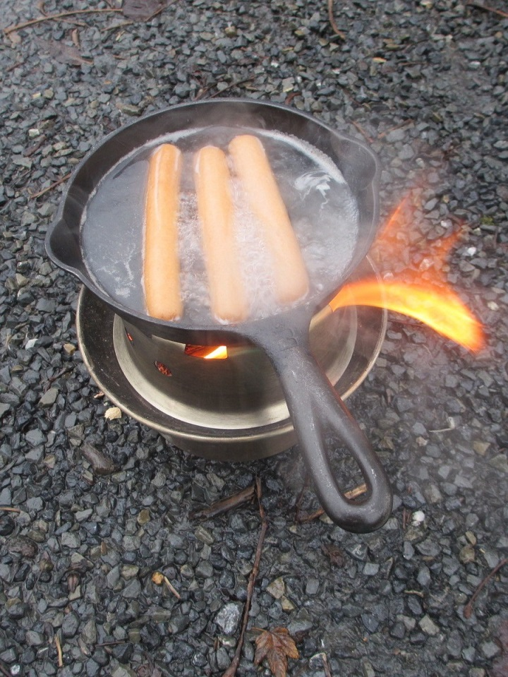 HA! Diggity Dogs. First time cooking hotdogs with our HOBO kit. Brilliant!