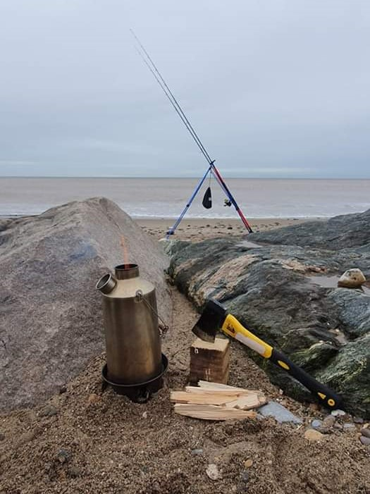Sea fishing at Mappleton Beach.  Making the best brews
