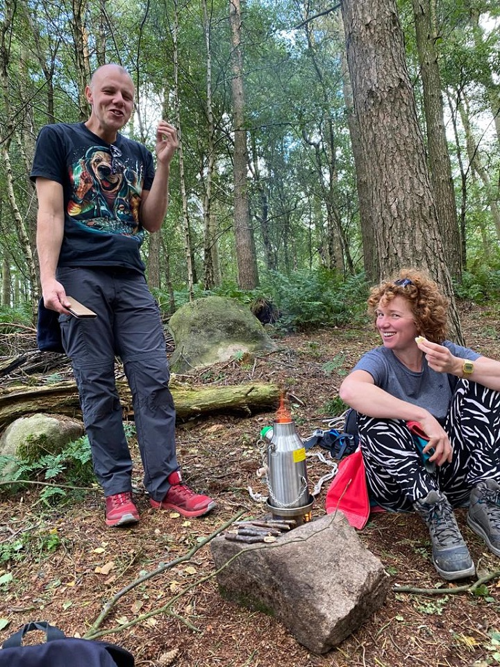 Family day in the woods, drinking tea and chilling in hammocks forest bathing. (Stanton Moor Birchover Stone Circle, Derbyshire, U.K.)