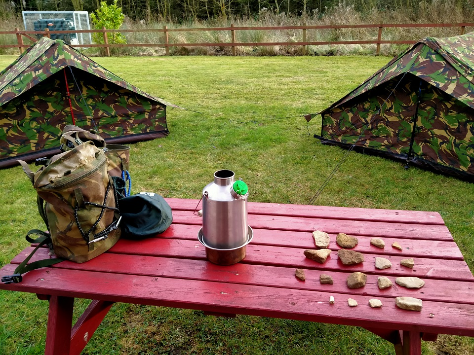 Locked down? Check! Rough weather? Check! Kelly kettle? Check!  Let's camp outside .... (Picture taken during a locked down wild camping intervention in work.)
