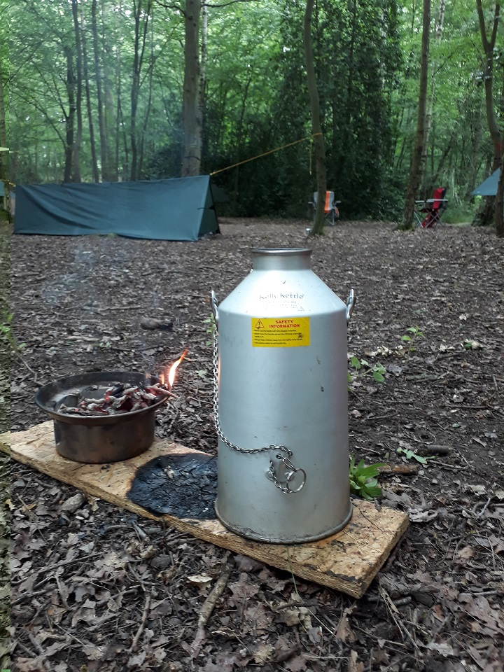 My Kelly kettle in use giving the explorer scouts a hot drink in minutes. Will need to buy 1 or 2 more. Tarp camping has never been so easy to have a brew